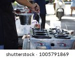 the chef pours a mixture of... | Shutterstock . vector #1005791869