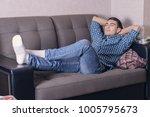 carefree young man relaxed on... | Shutterstock . vector #1005795673
