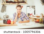 smiling woman holding her... | Shutterstock . vector #1005796306