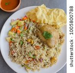 Small photo of Originated from southern asia,it's a mixed rice dish popular with the muslim of indian subcontinent / Nasi Briyani aka Briyani Rice / Usually eaten with chicken,mutton or fish with pickled vegetables