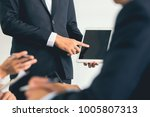 businessman using tablet and... | Shutterstock . vector #1005807313