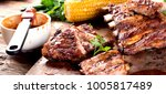 pork ribs with corn on a wooden ... | Shutterstock . vector #1005817489