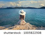 young woman sitting on the top... | Shutterstock . vector #1005822508