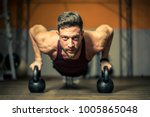 hard trained muscular man  | Shutterstock . vector #1005865048