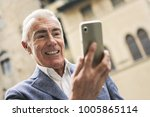 middle aged man doing a selfie  | Shutterstock . vector #1005865114