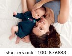 mother and newborn baby boy ... | Shutterstock . vector #1005876883