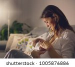 young beautiful mother ... | Shutterstock . vector #1005876886