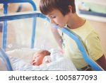 beautiful newborn baby boy ... | Shutterstock . vector #1005877093