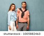 fashion girl and guy in outlet...   Shutterstock . vector #1005882463