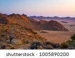rocky desert at dusk  colorful... | Shutterstock . vector #1005890200