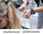 cut out of hairdresser's hands... | Shutterstock . vector #1005924334