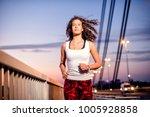 young caucasian woman running... | Shutterstock . vector #1005928858