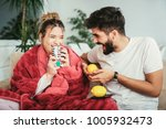 handsome man taking care of his ... | Shutterstock . vector #1005932473