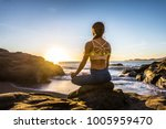 woman training yoga on the... | Shutterstock . vector #1005959470