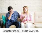 young man feeling worried after ... | Shutterstock . vector #1005960046