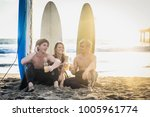 group of friends going to surf... | Shutterstock . vector #1005961774