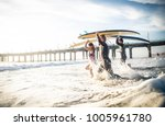 group of friends going to surf... | Shutterstock . vector #1005961780