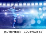 soccer player doing kick with... | Shutterstock . vector #1005963568
