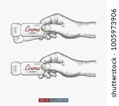 hand drawn hand holding cinema... | Shutterstock .eps vector #1005973906