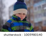 portrait of a european boy with ... | Shutterstock . vector #1005980140
