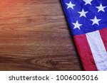 usa flag on brown wooden board. ... | Shutterstock . vector #1006005016