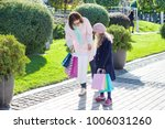 small fashionable girl and mom... | Shutterstock . vector #1006031260
