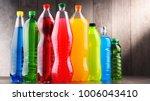 plastic bottles of assorted... | Shutterstock . vector #1006043410