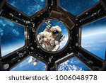 astronaut in outer space... | Shutterstock . vector #1006048978