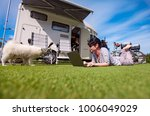 woman on the grass with a dog... | Shutterstock . vector #1006049029