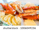 red king crab legs with fresh... | Shutterstock . vector #1006049236