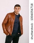brutal man in a leather jacket... | Shutterstock . vector #1006056718
