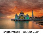malacca mosque on the beach in... | Shutterstock . vector #1006059604