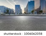 empty road with modern business ... | Shutterstock . vector #1006062058