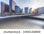 empty road with modern business ... | Shutterstock . vector #1006136800