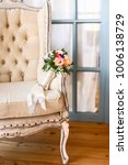 bridal bouquet on a chair.... | Shutterstock . vector #1006138729