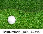 Golf Ball On Green Grass...