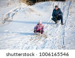 little girl child is towing... | Shutterstock . vector #1006165546