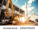 Small photo of construction equipment in construction new warehouse background
