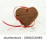 wooden heart with red ribbon on ...   Shutterstock . vector #1006216483