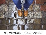 look down at the feet in yellow ... | Shutterstock . vector #1006220386