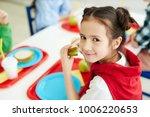 pretty young schoolgirl eating... | Shutterstock . vector #1006220653