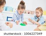 adorable little girls playing... | Shutterstock . vector #1006227349