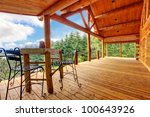 Large Porch Of The Log Cabin...
