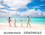 happy beautiful family on white ... | Shutterstock . vector #1006548163