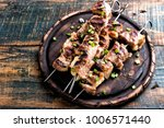 grilled meat skewers  shish... | Shutterstock . vector #1006571440