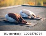 two young women doing yoga... | Shutterstock . vector #1006578739