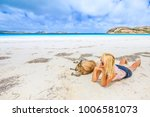 happy woman lying on pristine... | Shutterstock . vector #1006581073