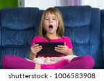 little girl sitting and play... | Shutterstock . vector #1006583908