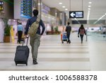 man carries luggage at the... | Shutterstock . vector #1006588378