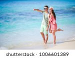 young couple on white beach... | Shutterstock . vector #1006601389